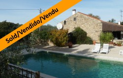 A nicely restored three bedroom stone cottage with landscaped gardens and swimming pool for sale near Tomar in central Portugal