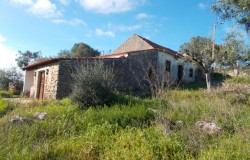 A stone house in need of some work with beautiful views over the hills for sale near Tomar, central Portugal