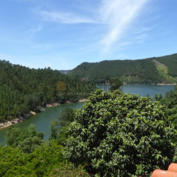 Three bedroom renovated house with a large plot of land bordering the Castelo do Bode lake near Dornes for sale. at Ferreira Do Zezere for 368000