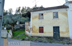 Semi-detached two bedroom old stone house for restoration on the main road for sale