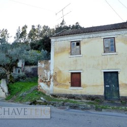 Semi-detached two bedroom old stone house for restoration on the main road for sale at Abrantes for 35000
