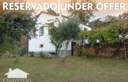 Structurally well preserved country house and a plot to build on, at the end of a pretty village for sale.