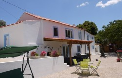 A three bedroom restored stone house with land and fantastic views, for sale near Tomar, Central Portugal.