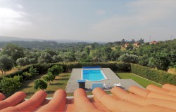 A well built and nicely finished property with a lovely swimming pool and land for sale near Tomar