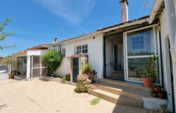 Four bedroom house with garage and land for sale near Tomar, Central Portugal.